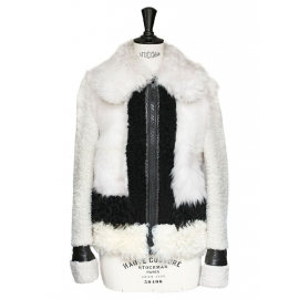 Beige and white shearling jacket with black leather trimming Retail price €3500 Size 38