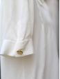 Blouse en soie écrue Px boutique environ 900€ Taille 36