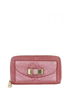 Portefeuille long LILY en cuir irisé rose avec noeud doré Px boutique 440€