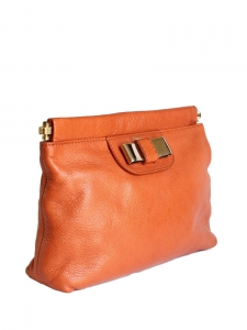 Coral pink leather pouch with golden bow Retail price €500
