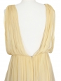 Robe dos nu en mousseline de soie plissée jaune pollen Px boutique 2800€ Taille 36