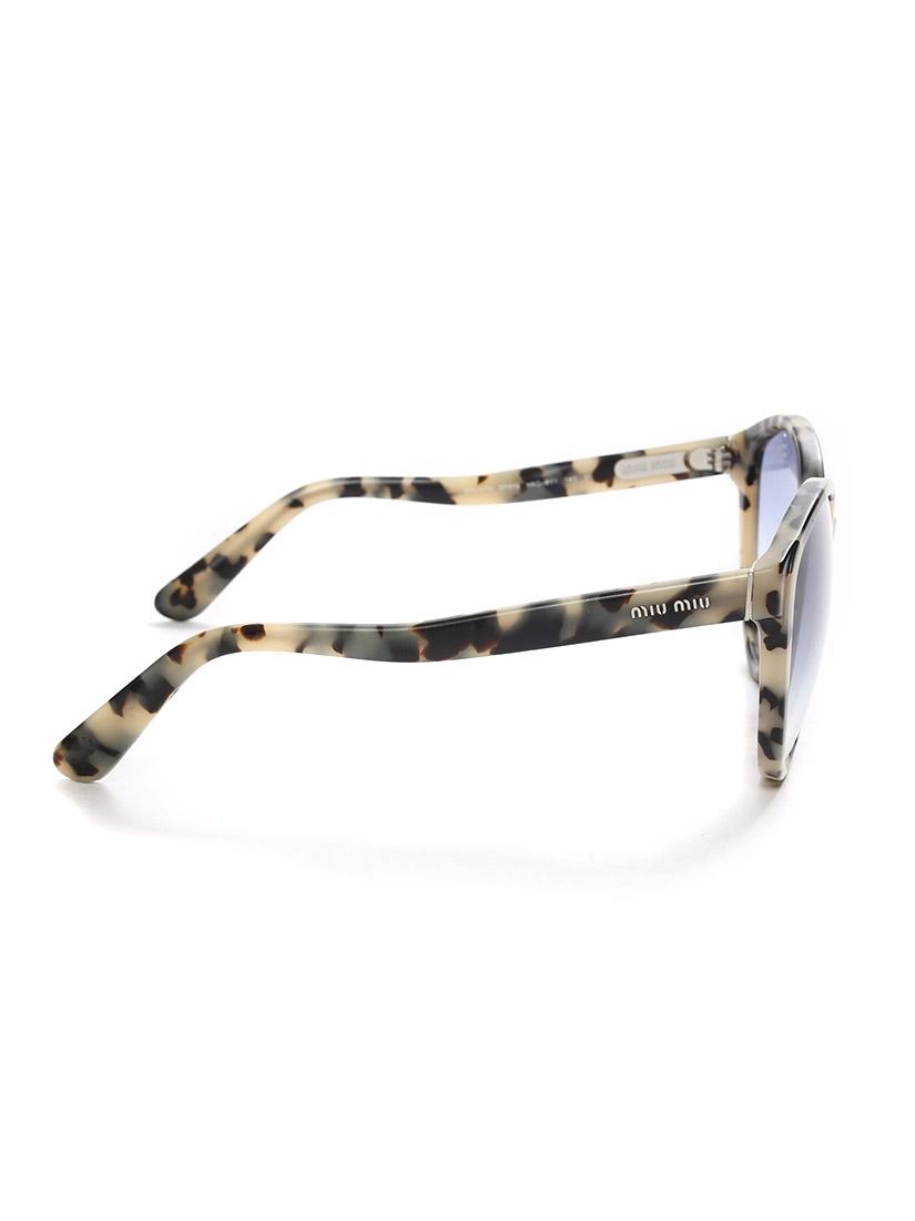 ... Lunettes de soleil œil-de-chat monture acétate écailles noir et beige  verre dégradé ... af5d3ae490a5