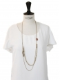 Long gold chain necklace with a coral pink stone