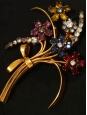 Red, pink, blue and yellow crystal flower-shaped golden-brass brooch