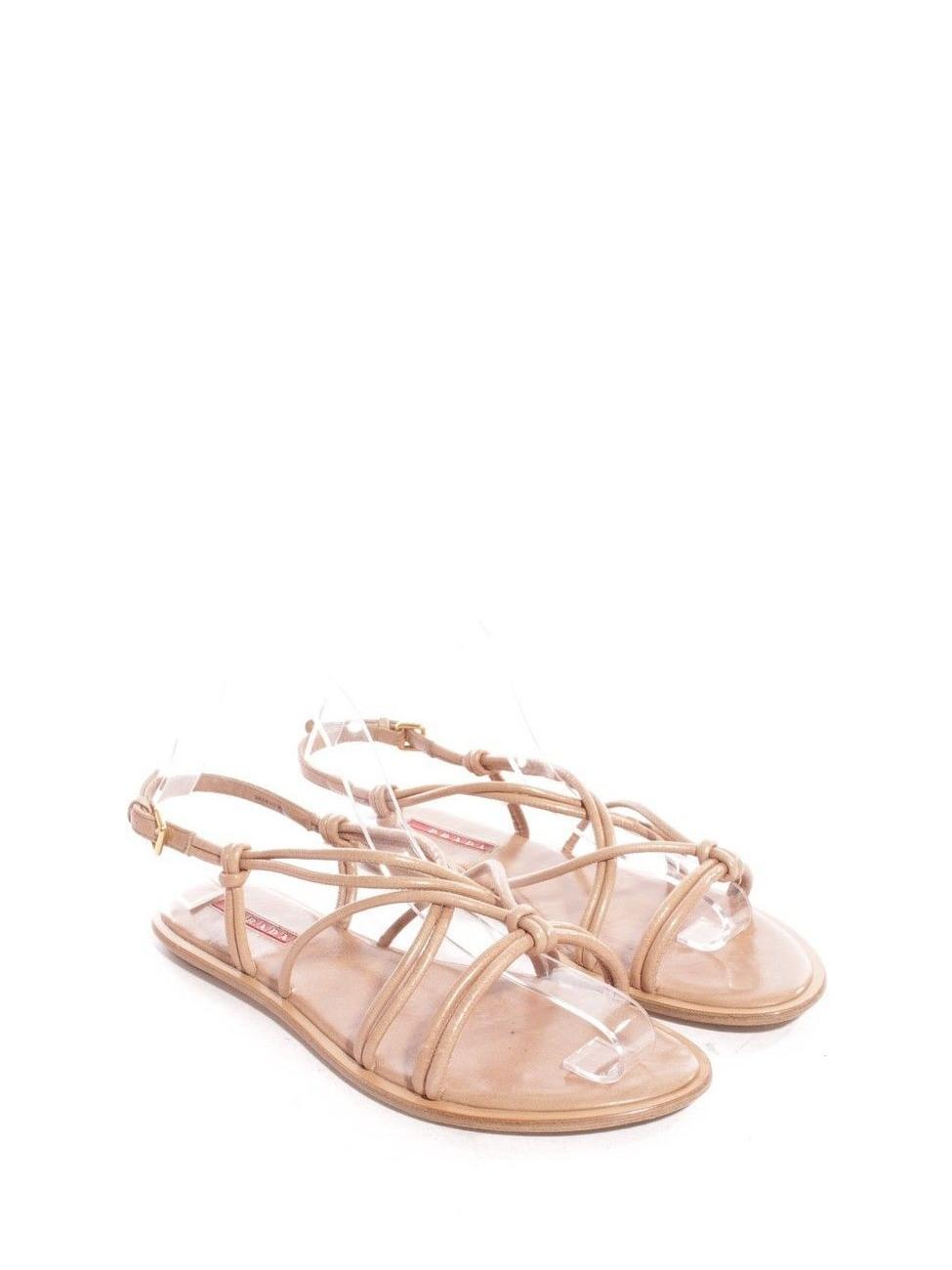 Louise Paris PRADA Sandales plates en cuir beige rosé