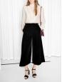 Pantalon court taille haute en velours noir Taille 34