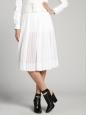 Jupe courte en jersey blanc à pois texturés Prix boutique 1400€ Taille 36
