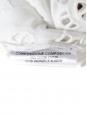 Top sans manche en dentelle de coton fleurie Px boutique 495€ Taille 36/38