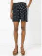 Short long taille haute en soie noir à pois blanc Prix boutique 450€ Taille 40