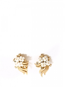 White flowers and gold clip earrings