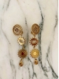 Boucles d'oreille soleil pendantes à clip en laiton finition dorée Prix boutique 350€