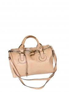 Sac duffle bag Aurore en cuir beige rosé Px boutique 1500€